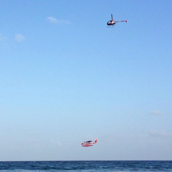 Helicopter chasing seaplane