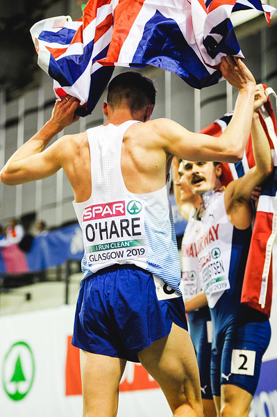Chris O'Hare celebrates his 1500 metre silver medal with the Ingebrigtsen brothers at the European Athletics Indoor Championships 2019