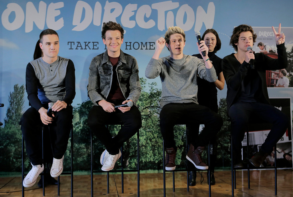 """. British boy band One Direction members, from left, Liam Payne, Louis Tomlinson, Niall Horan and Harry Styles, attend a news conference to promote their second album \"""" TAKE ME HOME \"""" in Tokyo, Friday, Jan. 18, 2013.(AP Photo/Itsuo Inouye)"""