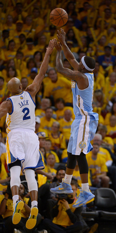 . OAKLAND, CA. - APRIL 26: Ty Lawson (3) of the Denver Nuggets takes a shot over Jarrett Jack (2) of the Golden State Warriors in game 3 of the first round of the NBA Playoffs April 26, 2013 at Oracle Arena.  (Photo By John Leyba/The Denver Post)