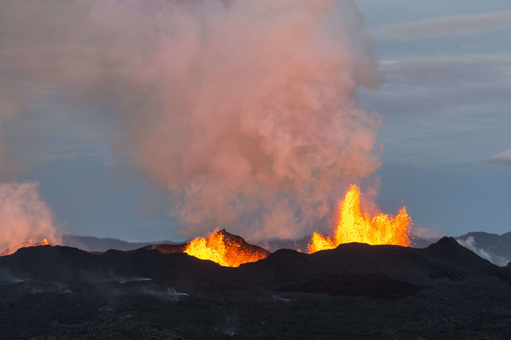 . An aerial picture taken on September 14, 2014 shows the Bardarbunga volcano spewing lava and smoke in southeast Iceland. The Bardarbunga volcano system has been rocked by hundreds of tremors daily since mid-August, prompting fears the volcano could explode. Bardarbunga, at 2,000 metres (6,500 feet), is Iceland\'s second-highest peak and is located under Europe\'s largest glacier, Vatnajoekull. BERNARD MERIC/AFP/Getty Images
