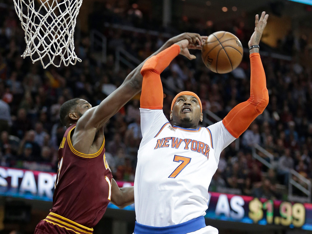 . Cleveland Cavaliers\' Tristan Thompson, left, and New York Knicks\' Carmelo Anthony battle for a rebound in the first half of an NBA basketball game, Thursday, Feb. 23, 2017, in Cleveland. (AP Photo/Tony Dejak)