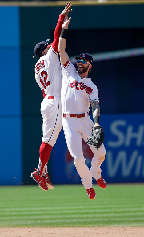 . Cleveland Indians\' Francisco Lindor, left, and Tyler Naquin celebrate after the Indians defeated the Pittsburgh Pirates 4-0 in a baseball game, Wednesday, July 25, 2018, in Cleveland. (AP Photo/Tony Dejak)