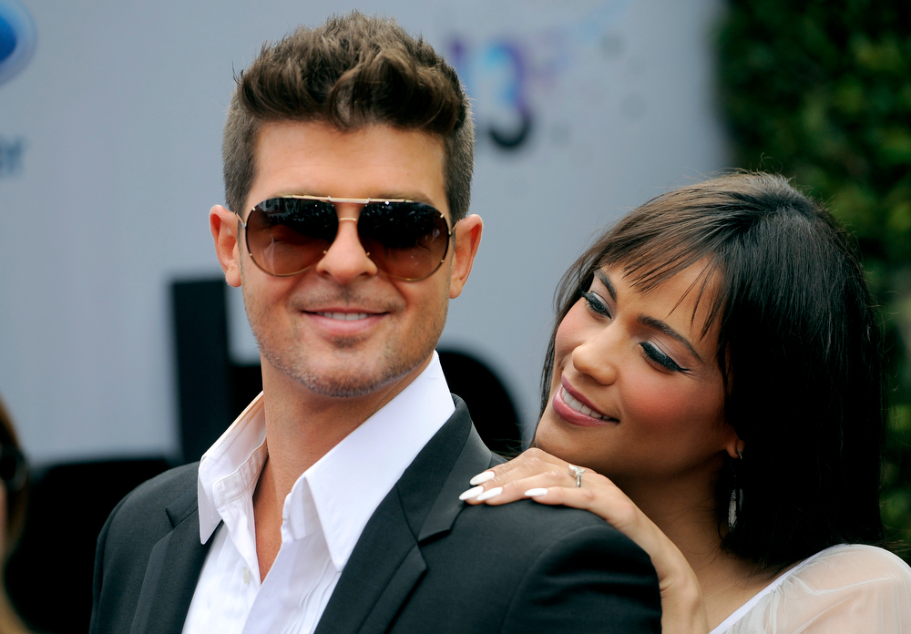 Description of . Robin Thicke and his wife Paula Patton arrive at the BET Awards at the Nokia Theatre on Sunday, June 30, 2013, in Los Angeles. (Photo by Chris Pizzello/Invision/AP)