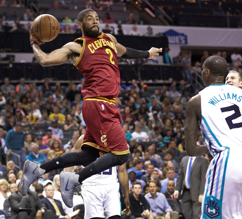 . Cleveland Cavaliers\' Kyrie Irving (2) looks to pass against the Charlotte Hornets during the second half of an NBA basketball game in Charlotte, N.C., Friday, March 24, 2017. The Cavaliers won 112-105. (AP Photo/Chuck Burton)