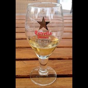 Local draft beer #incostabrava, Estrella Damm. Brewery founded 1876, August Keuntzmann Damm. Research via beer glass. #tbex