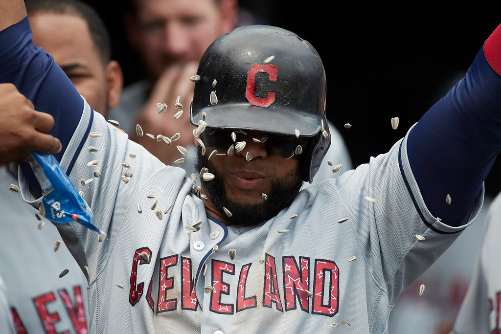 . Cleveland Indians Carlos Santana is congratulated by teammates after hitting a two run home run in the seventh inning against the Detroit Tigers in the first baseball game of a doubleheader in Detroit, Saturday, July 1, 2017. (AP Photo/Rick Osentoski)