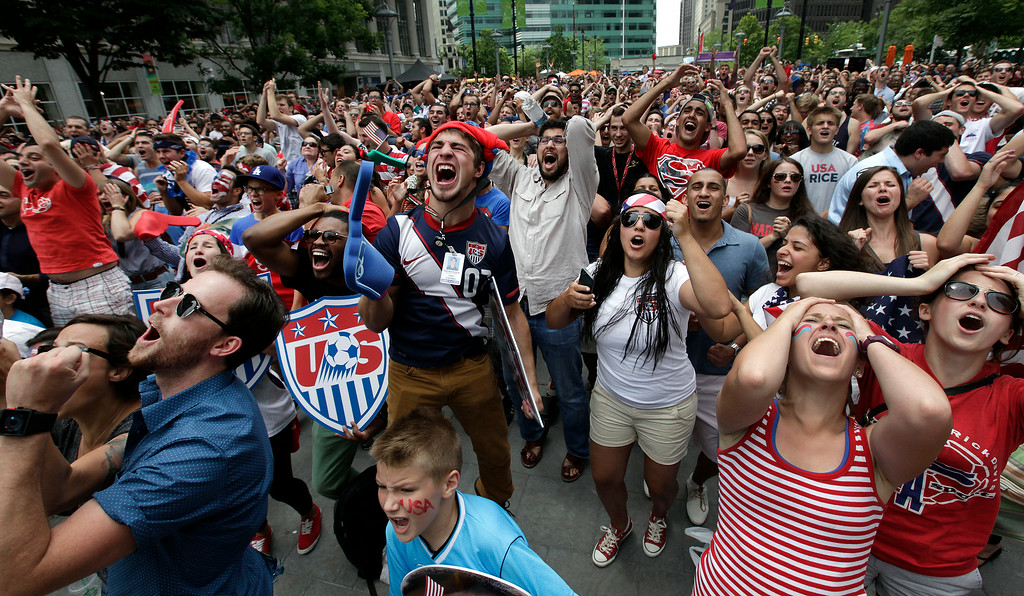 . United States fans react while watching the final minutes of the 2014 World Cup soccer match between the United States and Germany at a public viewing party, in Detroit, Thursday, June 26, 2014. Germany defeated the United States 1-0 to win Group G ahead of the Americans, who also advanced to the knockout stage of the World Cup despite losing. (AP Photo/Paul Sancya)