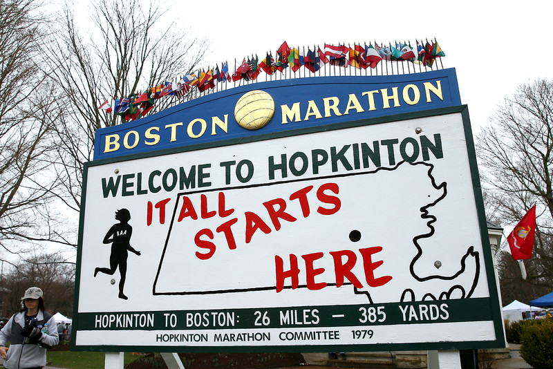 ". A view of a sign stating ""It All Starts Here\"" near the start in Hopkinton of the 119th Boston Marathon on April 20, 2015 in Boston, Massachusetts.  (Photo by Maddie Meyer/Getty Images)"