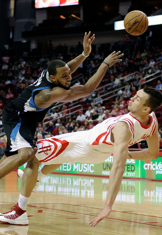 . Houston Rockets\' Donatas Motiejunas, right, is fouled by Minnesota Timberwolves\' Derrick Williams. (AP Photo/Pat Sullivan)