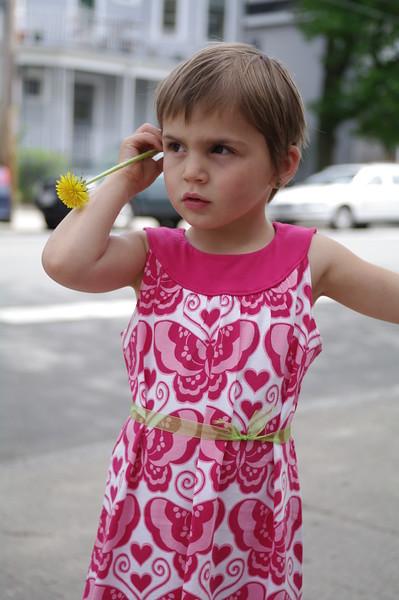 Anya with dandelion.