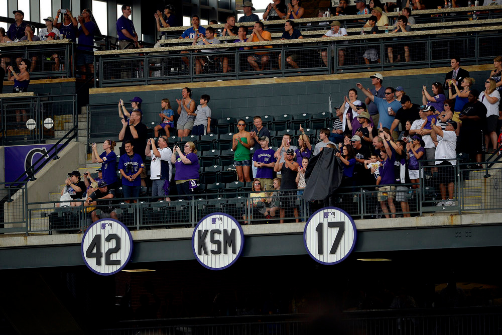 . Colorado Rockies great Todd Helton\'s number 17 is unveiled alongside Jackie Robinson\'s number 42 and a plaque honoring late team president Keli McGregor during a retirement ceremony honoring the recently retired Helton. Helton, who played 17 season with the Rockies and holds records for many of the organizations career statistics, was honored on Sunday, August 17, 2014. (Photo by AAron Ontiveroz/The Denver Post)