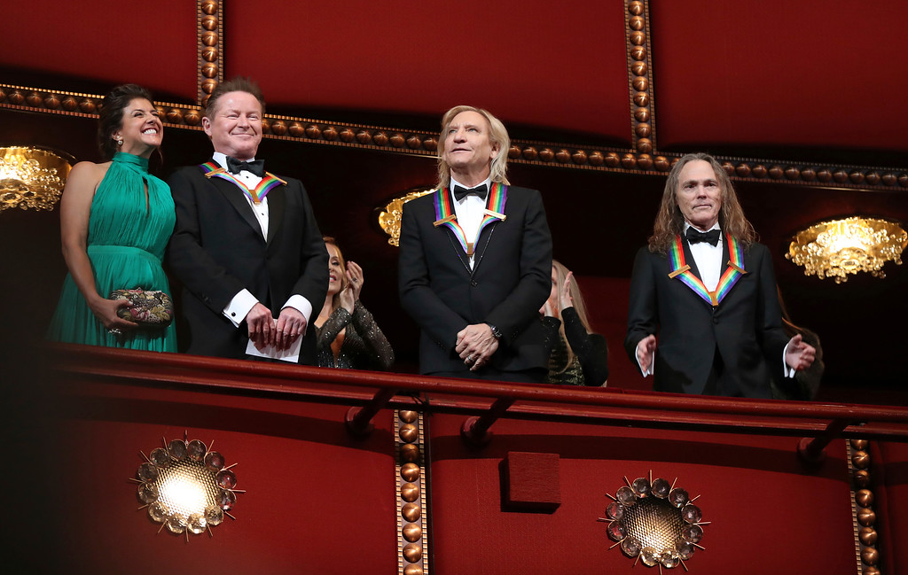 . Recipients of the 2016 Kennedy Center Honor award, the members of the Eagles band, from left, Don Henley, Joe Walsh, and Timothy Schmit, applaud during the Kennedy Center Honors Gala at the Kennedy Center in Washington, Sunday, Dec. 4, 2016. (AP Photo/Manuel Balce Ceneta)