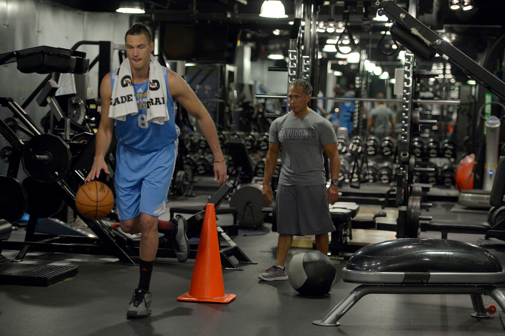 . Denver Nuggets Danilo Gallinari dribbles a basketball while balancing on one leg as he goes through a rigorous workout May 27, 2014 at Pepsi Center. Gallinari is rehabilitating his knee, which he injured against the Mavericks on April 4, 2013. Gallinari had surgery to reconstruct an ACL tear on January 21, 2014 by Dr. Steve Traina. Gallinari spends most of his day rehabilitating at the team facility with Steve Hess. (Photo by John Leyba/The Denver Post)