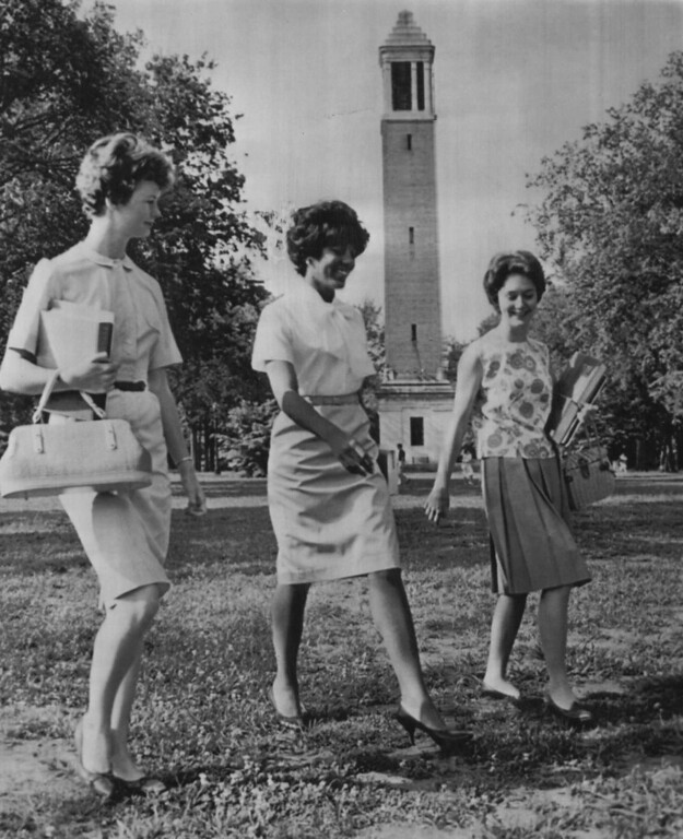 . Vivian Malone, accompanied by unidentified classmates, goes to her first class Wednesday at the University of Alabama. She and James Hood registered Tuesday, after Alabama Gov. George C. Wallace tried to bar them, to become the first Negroes to attend the southern college.