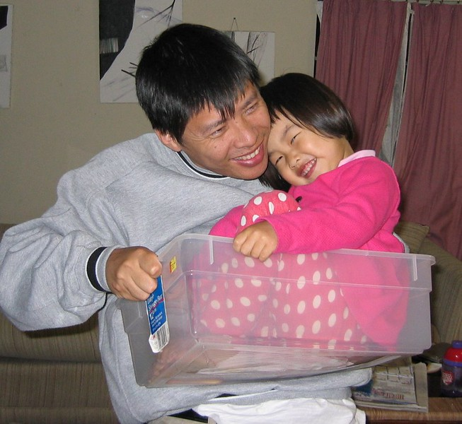 2004-4-Dady-hold ESther in box.jpeg