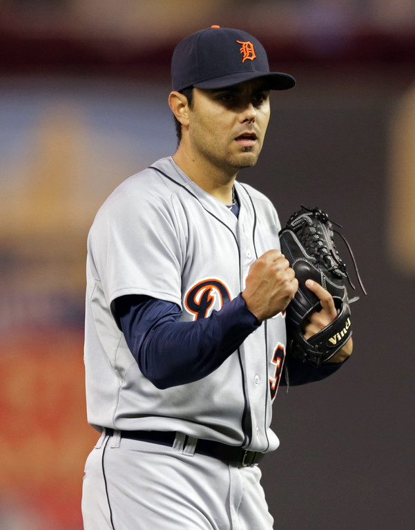 . Detroit Tigers pitcher Joakim Soria pumps his fist after the final out and picks up the save as the Tigers beat the Minnesota Twins 8-6 in a baseball game, Monday, Sept. 15, 2014, in Minneapolis. (AP Photo/Jim Mone)