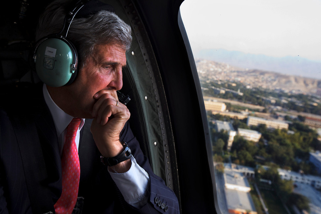 . U.S. Secretary of State John Kerry looks out the window en route to the ISAF headquarters after arriving on an unannounced visit in Kabul, Afghanistan, Friday, Oct. 11, 2013. Kerry flew to Afghanistan Friday for urgent talks with Afghan President Hamid Karzai as an end of October deadline looms for completing a security deal that would allow American troops to remain in Afghanistan after the end of the NATO-led military mission next year. (AP Photo/Jacquelyn Martin, Pool)