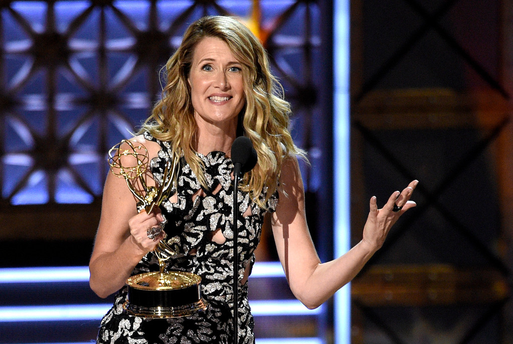 """. Laura Dern accepts the award for outstanding supporting actress in a limited series or movie for \""""Big Little Lies\"""" at the 69th Primetime Emmy Awards on Sunday, Sept. 17, 2017, at the Microsoft Theater in Los Angeles. (Photo by Chris Pizzello/Invision/AP)"""
