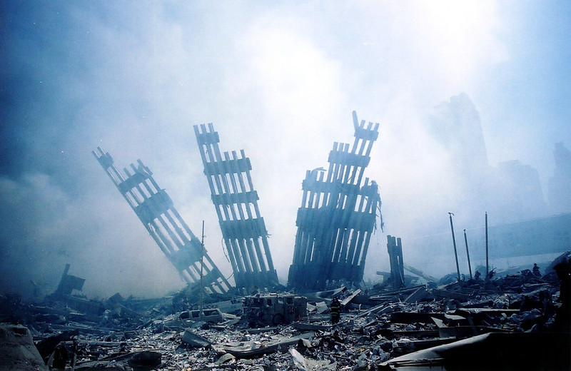 . The rubble of the World Trade Center smolders following a terrorist attack 11 September 2001 in New York.    AFP PHOTO/Alexandre Fuchs