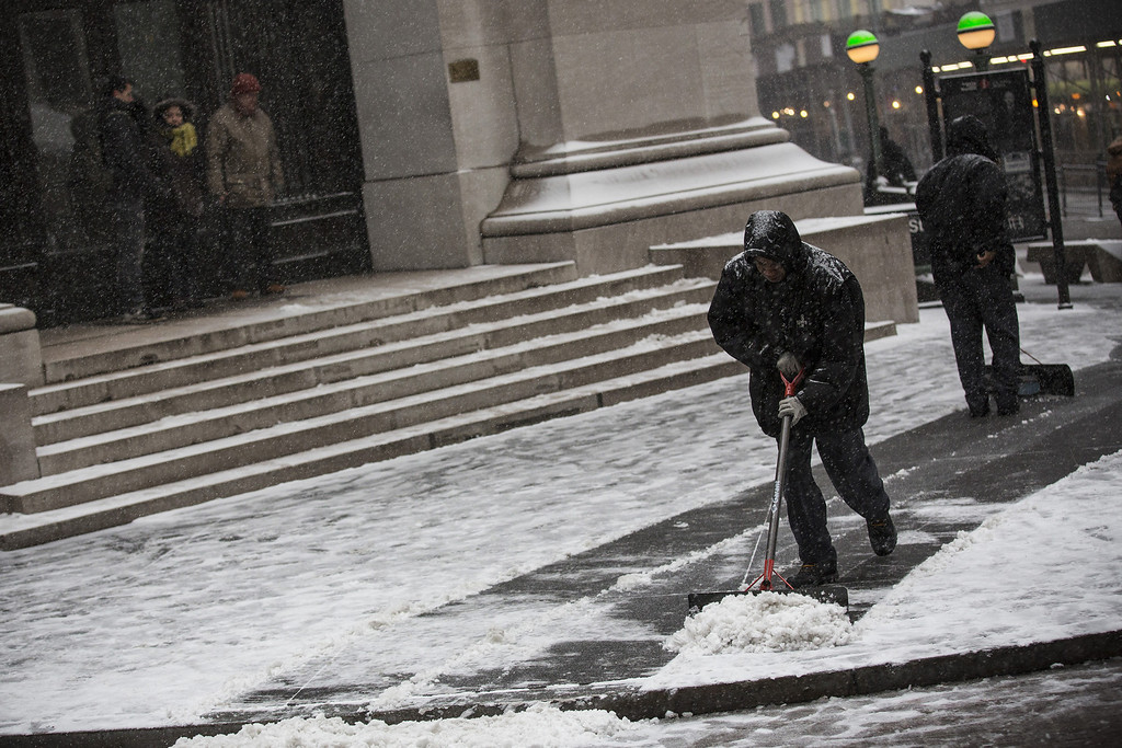 . A man shovels snow during a snow storm that is moving through the Northeast on January 21, 2014 in New York City.   (Photo by Andrew Burton/Getty Images)