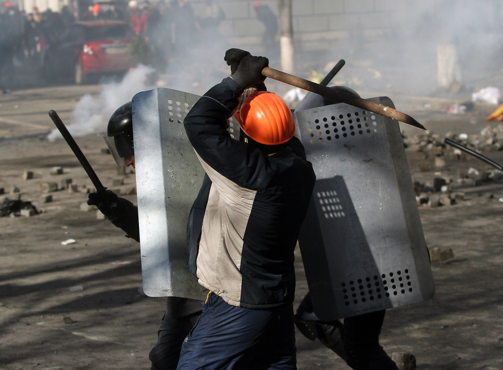 . Protesters clash with riot police in Kiev on February 18, 2014. Police on Tuesday fired rubber bullets at stone-throwing protesters as they demonstrated close to Ukraine\'s parliament in Kiev, an AFP reporter at the scene said. Police also responded with smoke bombs after protesters hurled paving stones at them as they sought to get closer to the heavily-fortified parliament building. AFP PHOTO/ ANATOLII  BOIKO/AFP/Getty Images