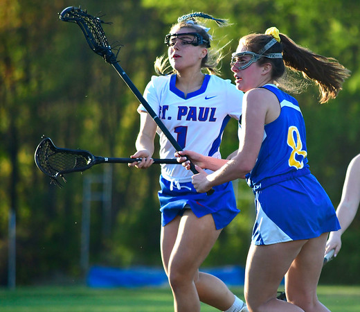 5/8/2019 Mike Orazzi | Staff St. Paul Catholic High School's Emma Cretella (1) and Housatonic Regional's Genevieve Bushey (8) during Wednesday's girls lacrosse in Bristol.