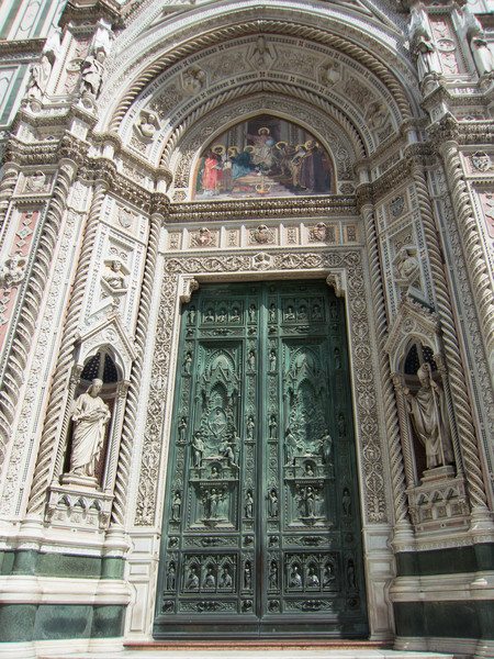 The bronze bas-relief door that is the main entrance to the Duomo (c. 1900).