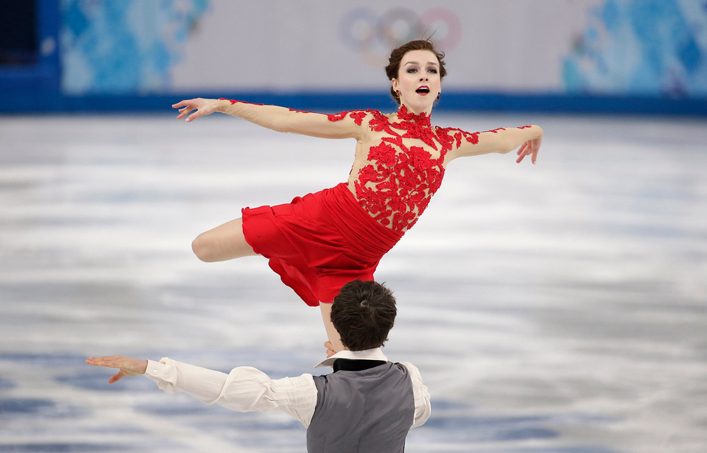 . Alexandra Paul and Mitchell Islam of Canada compete in the ice dance free dance figure skating finals at the Iceberg Skating Palace during the 2014 Winter Olympics, Monday, Feb. 17, 2014, in Sochi, Russia. (AP Photo/Bernat Armangue)