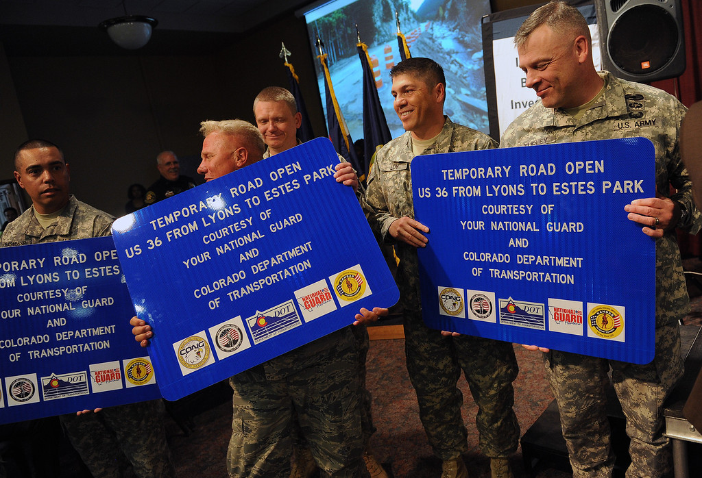 . LONGMONT, CO - OCTOBER 29:   Members of the Utah, Kansas and Colorado National guard received highway signs from the Colorado Department of Transportation as thanks for their work during the floods  at the Life Bridge Community Church in  Longmont, Co on October 29, 2013.  They were on hand for a celebration in their honor to say thanks for the work they did during and after the floods. (Photo By Helen H. Richardson/ The Denver Post)