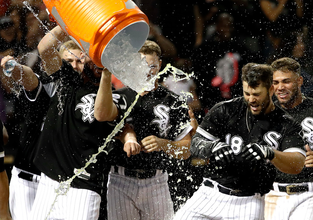 . Chicago White Sox\'s Daniel Palka (18) celebrates with teammates after hitting the game-winning solo home run against the Cleveland Indians during a baseball game Friday, Aug. 10, 2018, in Chicago. The White Sox won 1-0. (AP Photo/Nam Y. Huh)