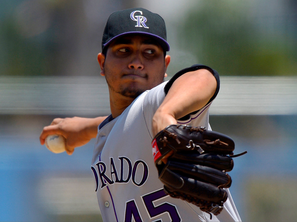 . Colorado Rockies starting pitcher Jhoulys Chacin throws to the plate during the first inning of their baseball game against the Los Angeles Dodgers, Sunday, July 14, 2013, in Los Angeles. (AP Photo/Mark J. Terrill)