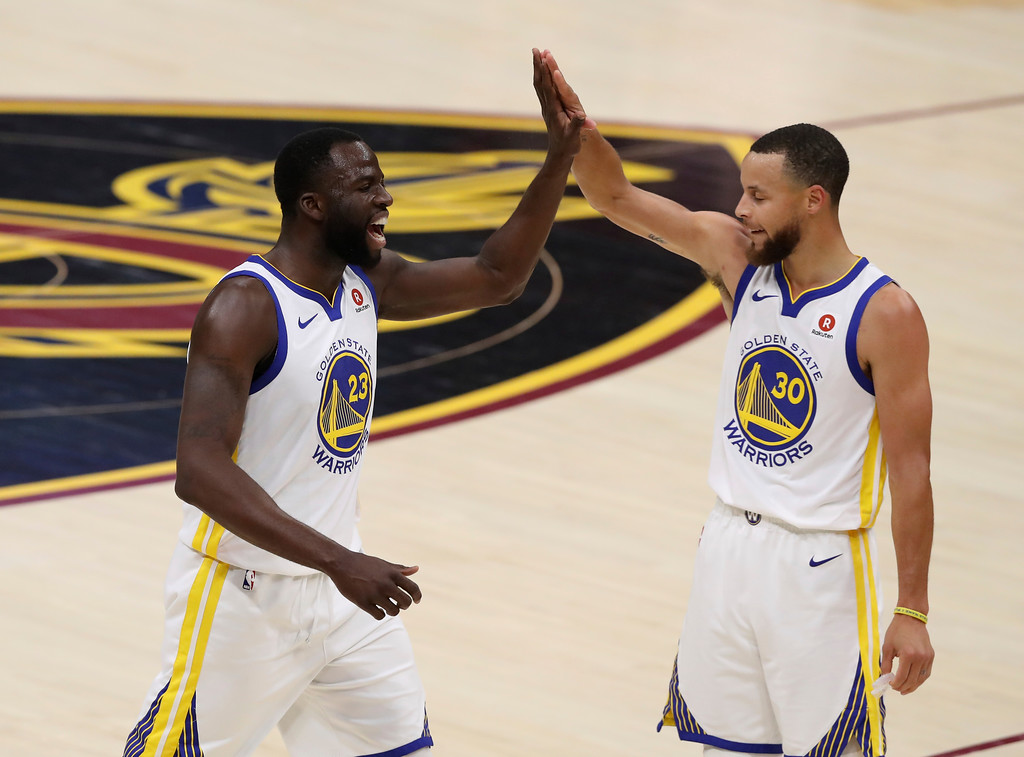 . Golden State Warriors\' Draymond Green, left, and Stephen Curry celebrate during the first half against the Cleveland Cavaliers in Game 3 of basketball\'s NBA Finals, Wednesday, June 6, 2018, in Cleveland. (AP Photo/Carlos Osorio)