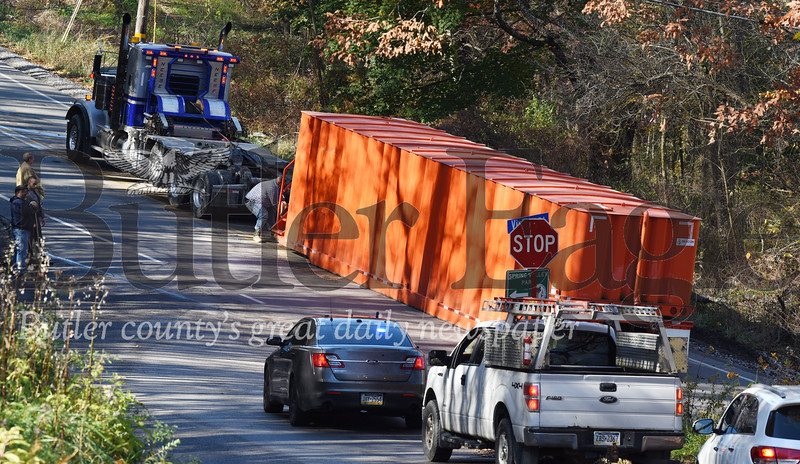 Harold Aughton/Butler Eagle: A truckdriver accidently dumped the container he was hauling Monday at the intersection of Victory and Dinnerbell road near Saxonburg Monday afternoon.