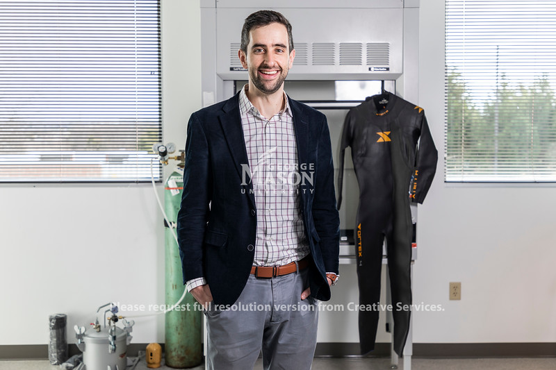 Jeff Moran, assistant professor of mechanical engineering in the Volgenau School of Engineering, is working to make wetsuits more effective and keep divers warmer longer. Photo by Lathan Goumas/Strategic Communications