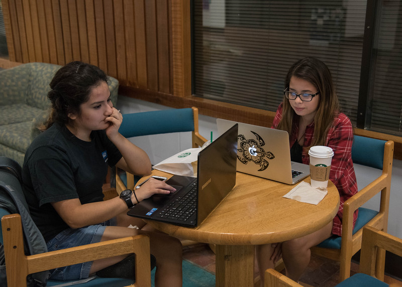 Students Veronica Alviso and Alysa Sauceda work on a group project in the Faculty Center.