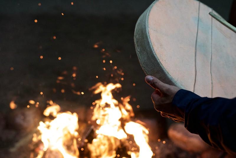 Warming up dene drum in Fort Nelson.