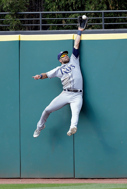 . Tampa Bay Rays\' Kevin Kiermaier jumps to catch a fly ball hit by Cleveland Indians\' Jason Kipnis for the last out in the ninth inning of a baseball game, Wednesday, May 17, 2017, in Cleveland. The Rays won 7-4. (AP Photo/Tony Dejak)