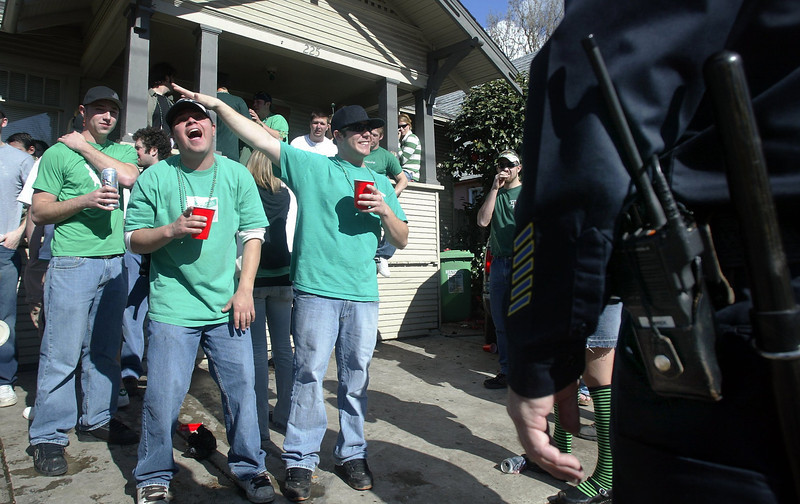 Partiers aren't afraid to have a good time right in front of Chico Police at a house located at 225 Ivy st. near 2nd st. Friday afternoon for St. Patrick's Day. Police were called to this residence more than one time. - halley photo 3/17/06