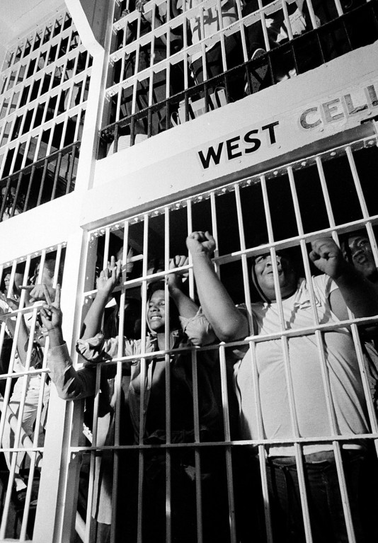 ". In this July 28, 1973 file photo, convicts give the ""V\"" for victory and clenched fist sign to newsmen who were allowed to view the West Cell Block at Oklahoma State Prison, as rioting subsided and many returned to their cells. The OSP had 2,200 inmates at the time, twice its capacity. The prison erupted into violence on July 27, 1973, the result of overcrowding, inadequate supervision, poor health care and a culture of violence within the prison walls. (AP Photo/Staff, File)"