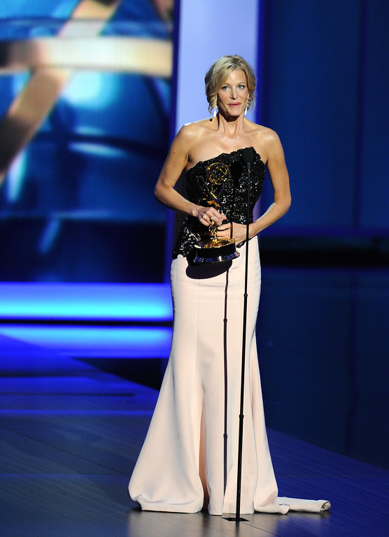 . Winner of Best Supporting Actress in a Drama Series, Anna Gunn speaks onstage during the 65th Annual Primetime Emmy Awards held at Nokia Theatre L.A. Live on September 22, 2013 in Los Angeles, California.  (Photo by Kevin Winter/Getty Images)
