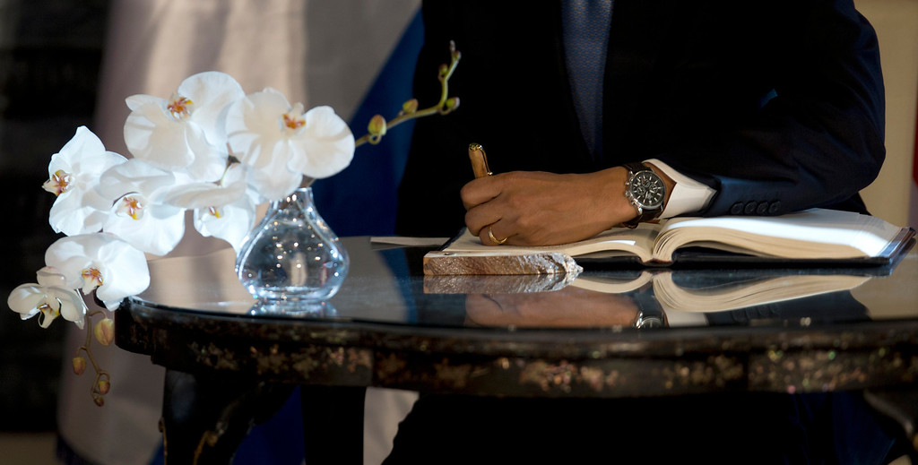 . President Barack Obama signs a guest book, Wednesday, March 20, 2013, at the residence of Israeli President Shimon Peres in Jerusalem. (AP Photo/Carolyn Kaster)
