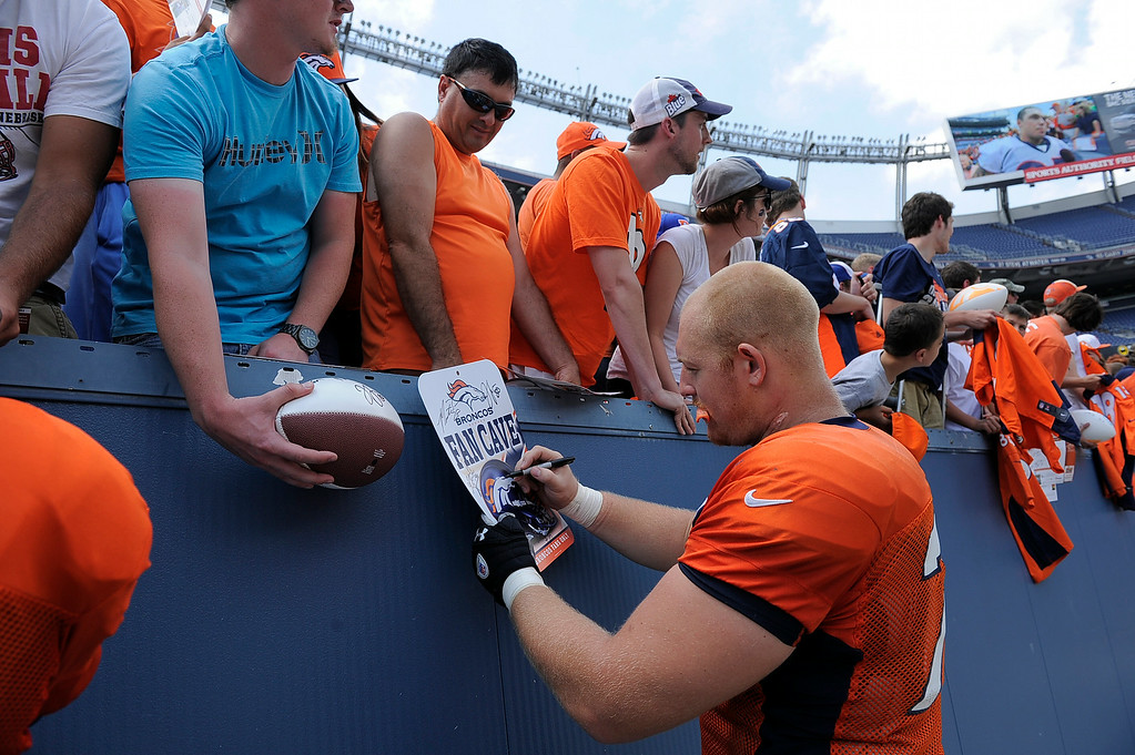 . Denver Broncos offensive guard Ryan Miller (73) signs autographs after practice on day four of the Denver Broncos 2014 training camp July 27, 2014 at Sports Authority Field at Mile High. (Photo by John Leyba/The Denver Post)