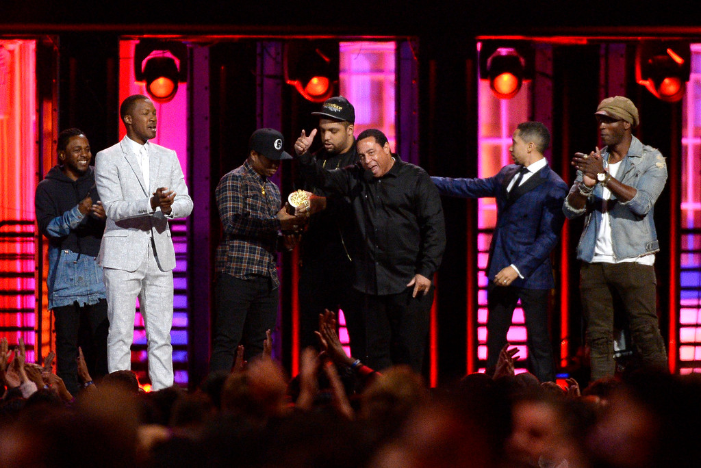 ". Kendrick Lamar, from left, Corey Hawkins, Jason Mitchell, O\'Shea Jackson Jr., DJ Yella, Neil Brown Jr., and Aldis Hodge accept the True Story award for ""Straight Outta Compton\"" at the MTV Movie Awards at Warner Bros. Studio on Saturday, April 9, 2016, in Burbank, Calif. (Kevork Djansezian/Pool Photo via AP)"
