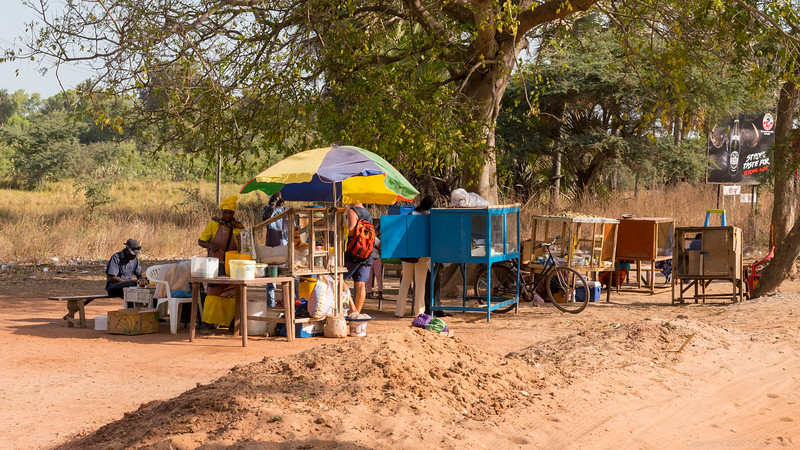 Roadside Vendors - The blue cabinet is where the Tapalpa fillings are stored and dispensed  - The Gambia 2020.JPG
