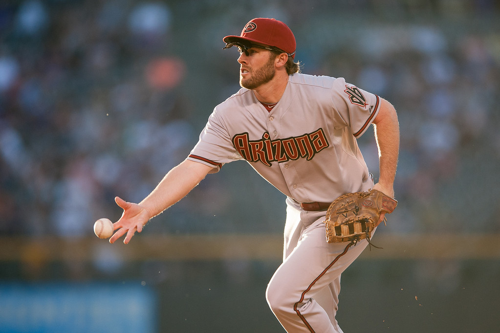 . Nick Evans #28 of the Arizona Diamondbacks makes a defensive putout after fielding a ground ball at first base against the Colorado Rockies at Coors Field on June 3, 2014 in Denver, Colorado.  The Diamondbacks held a 3-0 lead in the bottom of the fourth inning. (Photo by Dustin Bradford/Getty Images)