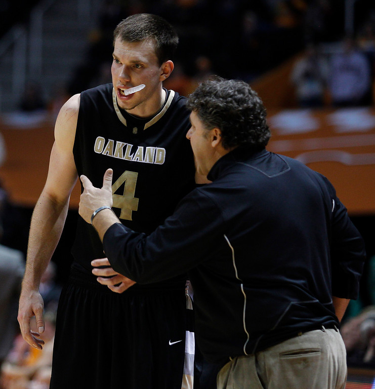 . Oakland coach Greg Kampe, right, gives instruction to Oakland forward Will Hudson (4) during the second half of an NCAA college basketball game Wednesday, Dec. 14, 2010 in Knoxville, Tenn. Oakland won 89-82. (AP Photo/Wade Payne)