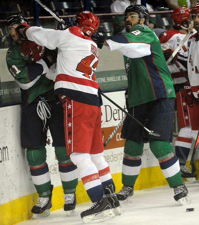 . DENVER, CO - MAY 2: Jean-Phillipp Chabot (11) of the Denver Cutthroats gets punched in the face by Ross Rouleau (42) of the Allen Americans during the first period of game 1 of the Ray Miron Presidents Cup Finals at the Denver Coliseum in Denver, Colorado on May 2, 2014. (Photo by Seth McConnell/The Denver Post)