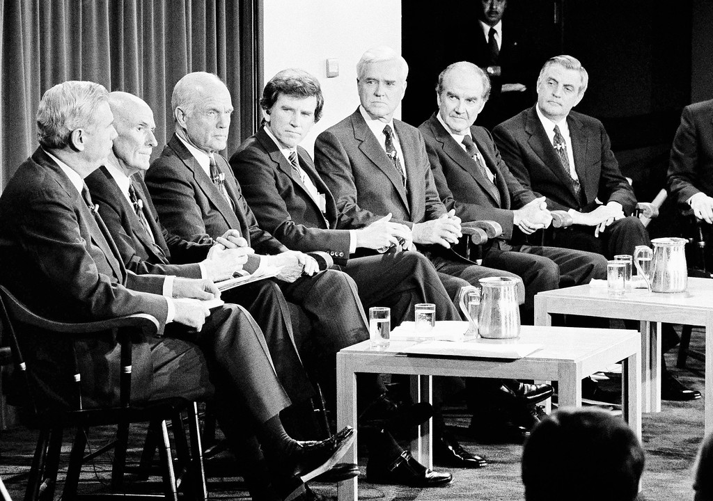 . Seven Democratic presidential candidates appear on stage at the Kennedy School of Government at Harvard University in Cambridge, Massachusetts, Oct. 14, 1983, where they met to debate the nuclear arms issue. The seven candidates from left are; former Gov. Reuben Askew, Sen. Alan Cranston, Sen. John Glenn, Sen. Gary Hart, Sen. Ernest Hollings, former Sen. George McGovern, and former Vice President Walter Mondale. (AP Photo/Paul R. Benoit)