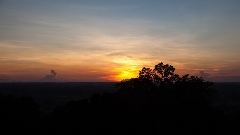 A beautiful sunset from from atop Phnom Bakheng. The temple itself was cut from the rock that made up the hill that it sits on. From the top, you could see Angkor Wat, the Great Lake (Tonle Sap) and many miles of fields and jungle.
